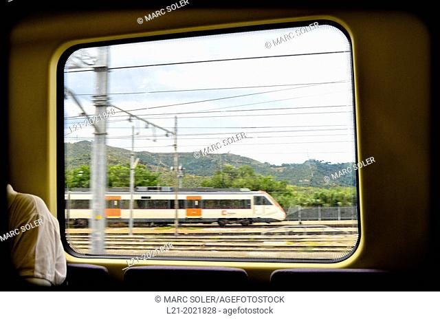 Vision of a moving train through a window. Barcelona province, Catalonia, Spain