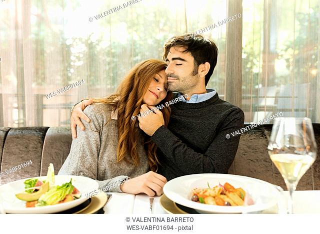 Couple in love sitting at table in a restaurant