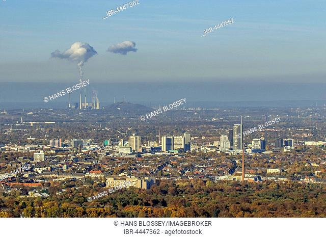 Cityscape with skyscrapers, power company Innogy with smoking chimneys behind, Essen, Ruhr district, North Rhine-Westphalia, Germany