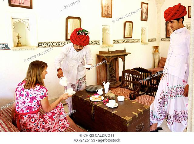 Tea being served to a tourist in Heritage Hotel; Rajasthan, India