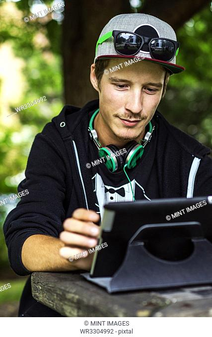 Caucasian man using digital tablet outdoors