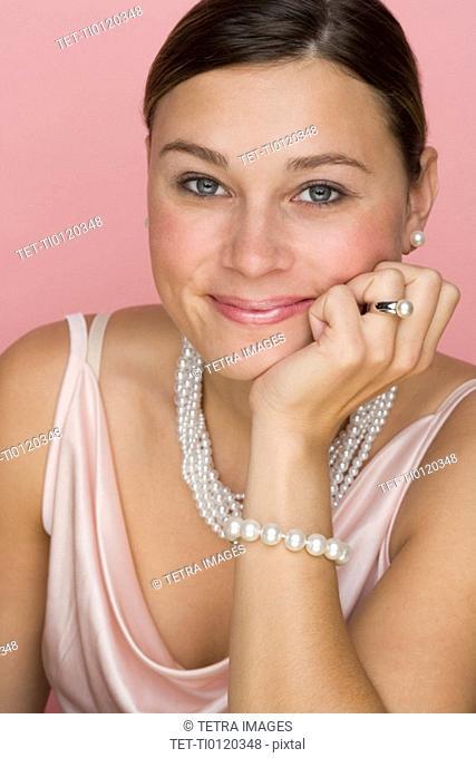 Studio shot of woman wearing pearls