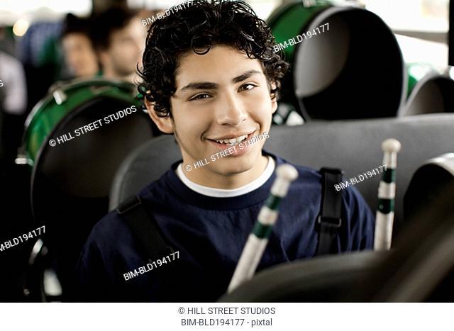 Hispanic band student riding school bus