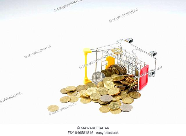 Toy trolley and coin with white background. Financial concept