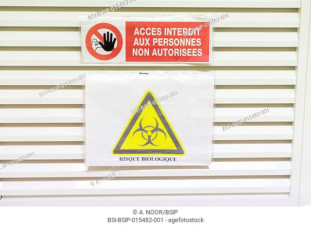 Reportage in the reproductive biology service in Nice hospital, France. No entry and biological risk sign