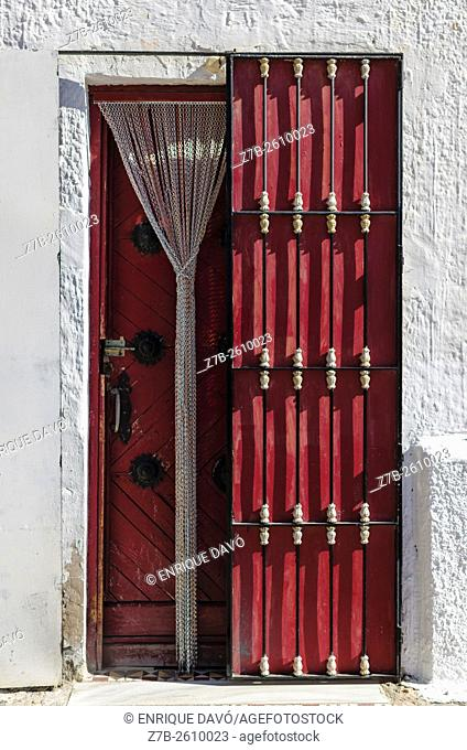 A wooden door view in Carboneras town, Almería province, Spain