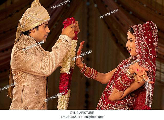 Indian bride rejecting a groom with a garland