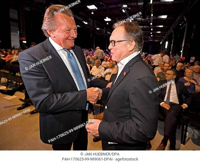 Former president Harald Strutz (FSV Mainz 05) congratulates his successor, the new Mainz president Johannes Kaluza during the general assembly of the first...