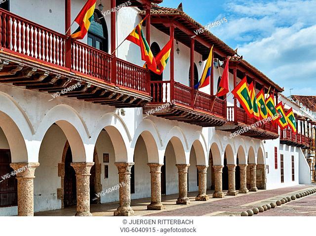 flags of Cartagena on town hall Alcaldia Mayor, historical facade on Plaza de la Aduana, Cartagena de Indias, Colombia, South America - Cartagena de Indias