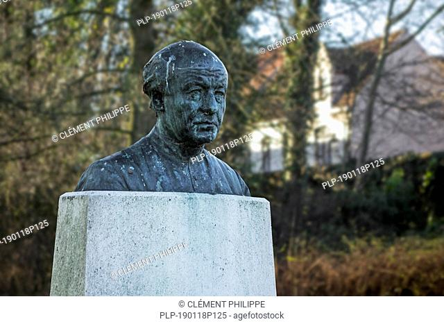 Bust of the Flemish poet Guido Gezelle in garden at birthplace in the city Bruges, West Flanders, Belgium