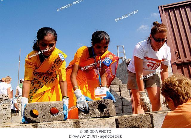 Volunteers build houses at the 23rd Jimmy Carter Work Project at Patan Village ; near Lonavala ; Maharashtra ; India