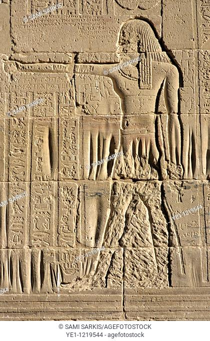 Stone walls depicting hieroglyphs at the Temple of Isis First Pylon at Philae, Egypt
