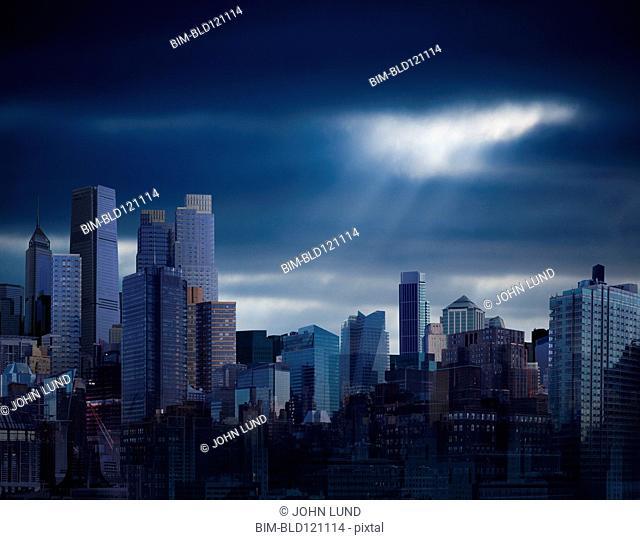 City skyline under stormy sky