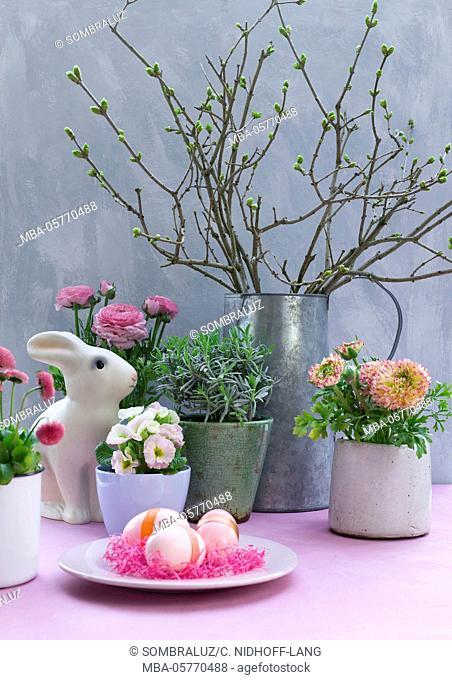 Easter bunny between flowers
