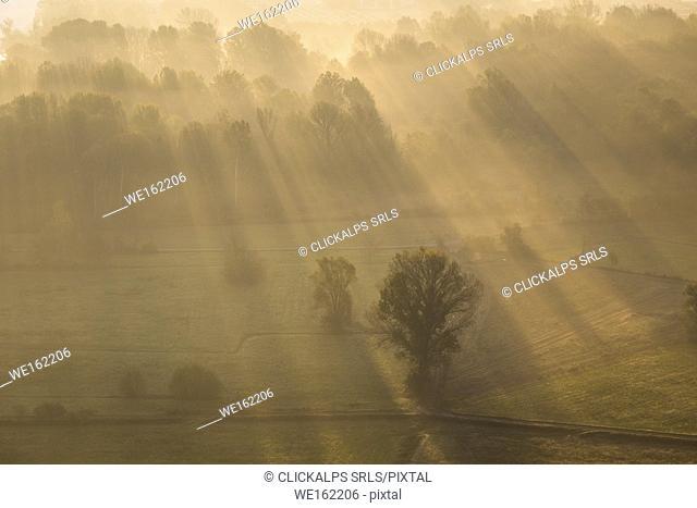 Mist over Adda river seen from Airuno at the Santuario Madonna della Rocchetta, Airuno, Parco dell'Adda Nord, Lecco province, Brianza, Lombardy, Italy