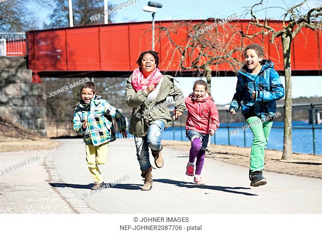 Mother running with children