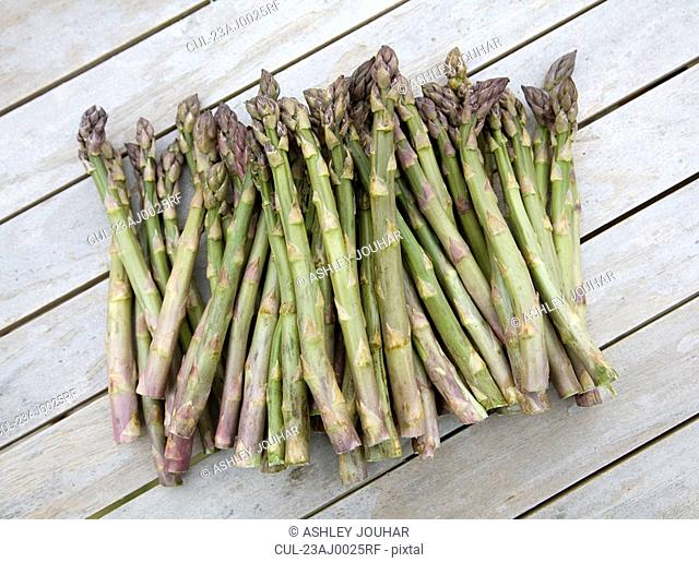 Bunch of asparagus on wood surface