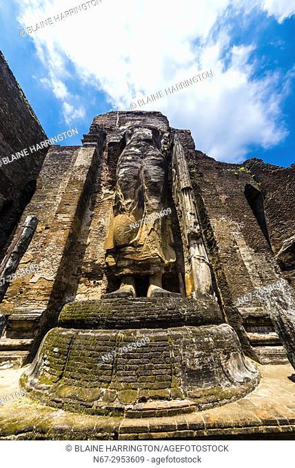 Headless Buddha statue, Lankatilaka Vihara , Ruins of ancient city, Polonnaruwa, Sri Lanka