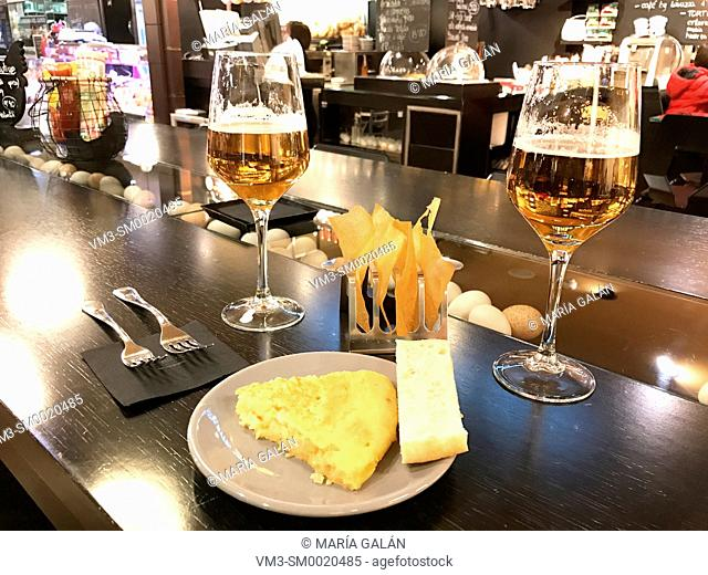 Two glasses of beer with Spanish omelet in a bar. Madrid, Spain