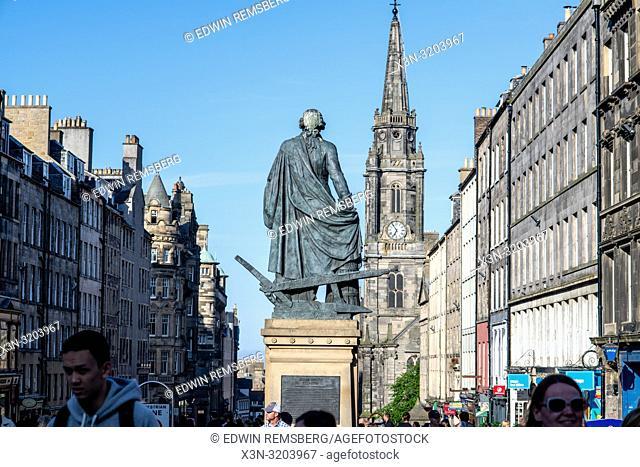 A statue of famous Economist Adam Smith stands staunchly facing the city, Edinburgh, Scotland, UK