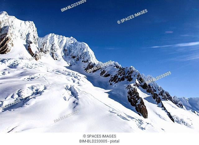 Snow on sunny mountain