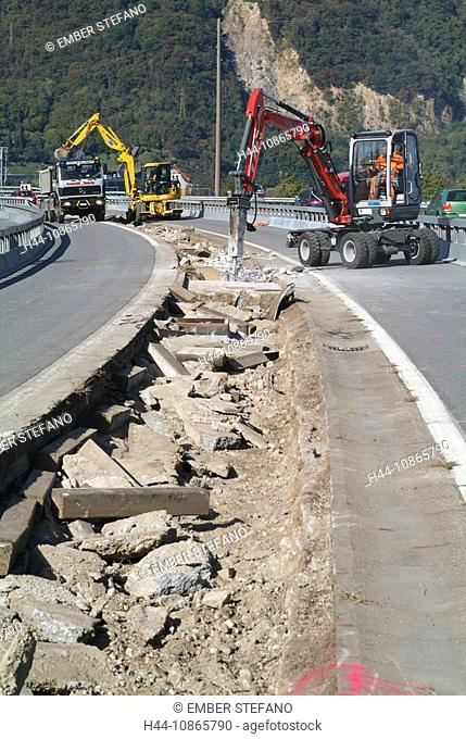 Switzerland, Ticino, Bissone, autospell, roadworks, road construction, excavator, paving, construction machines