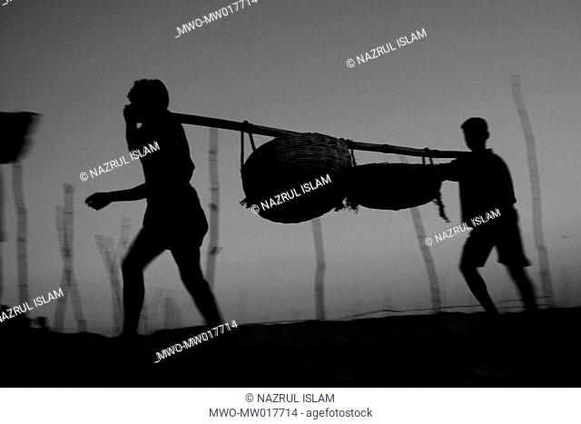 Fisher men are going to collect fishes from fishing boats early in the morning, at Dublarchar, Bagherhat, Khulna, Bangladesh November 12, 2008