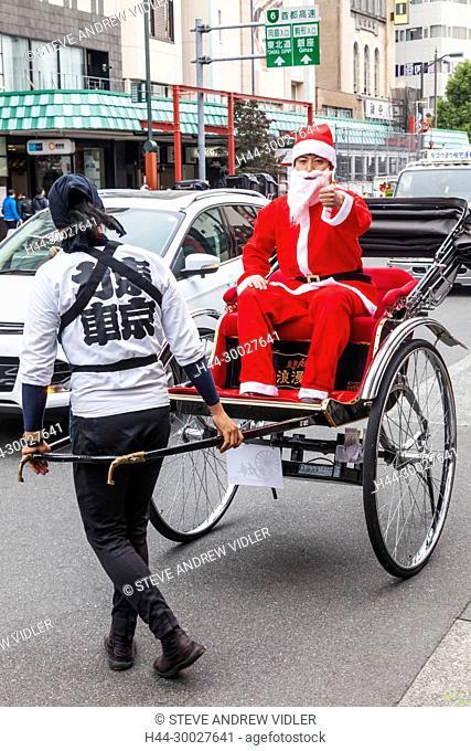 Japan, Hoshu, Tokyo, Asakusa, Man Dressed as Father Christmas in Rickshaw