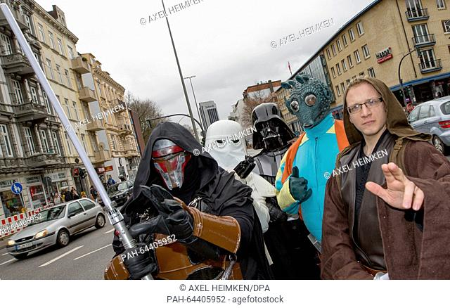 Members of a local 'Star Wars' fan club dressed as characters from the Star Wars movies Darth Revan (l-r), a Snowtrooper, Darth Vader
