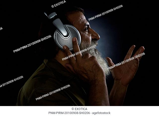 Profile of a man listening to headphones