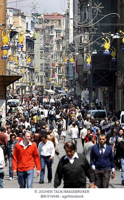 People walking through the main pedestrian zone, Istiklal Caddesi in the Boyoglu district, Sultanahmet, Istanbul, Turkey
