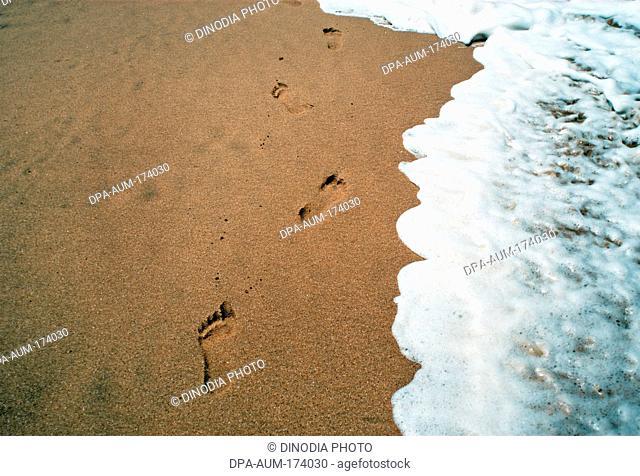 Surf near footprints at anjuna beach ; Goa ; India 8-May-2008