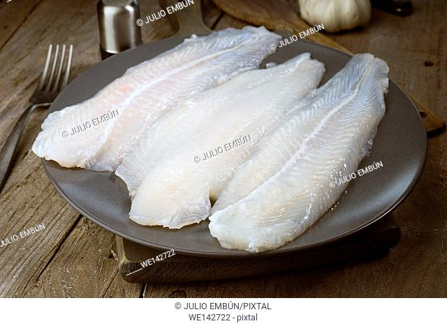 raw fish fillets freshly caught in dish on wood