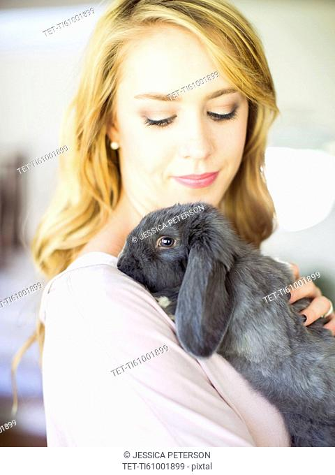 Young woman stroking her bunny