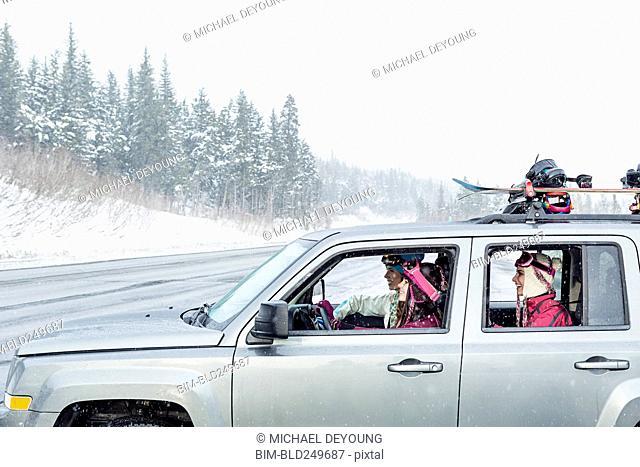 Friends driving in car in winter