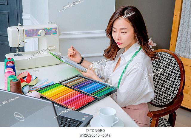 Female fashion designer working