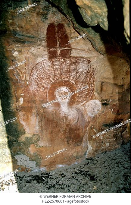 Aboriginal cave painting of a Wandjina. The Wandjina are a group of ancestral beings from the sea and sky that bring rain and control the fertility of the...