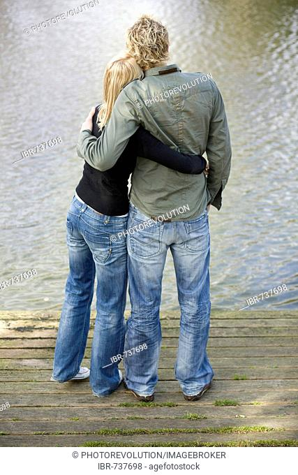 Couple hugging on a wooden dock