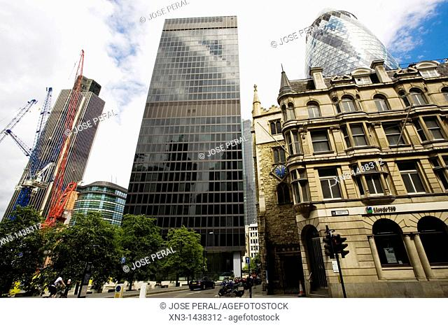 St Mary Axe Street, on backgroun at right, the Swiss Re Tower or The Gherkin, Norman Foster architect, City of London, London, England, UK