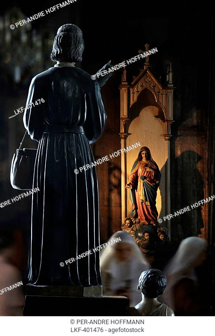 Nuns and statues in Basilica de San Sebastian, the only all steel church in Asia, Manila, Philippines, Asia