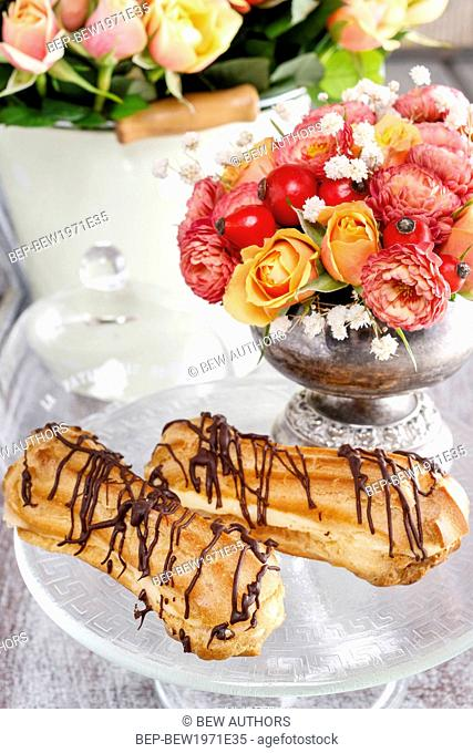 Eclairs on cake stand. Party dessert