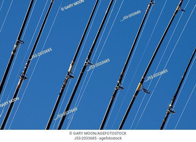 Fishing poles on ocean charter fishing boat, Oregon