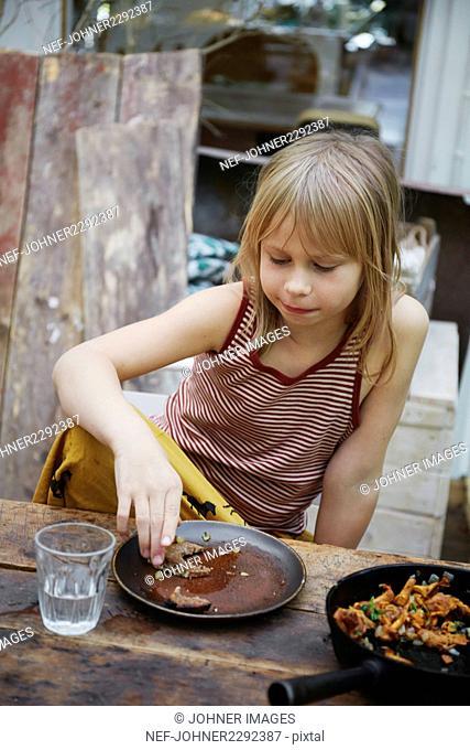 Girl eating lunch in garden