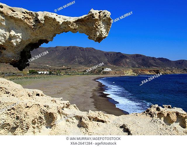 Beach and sculpted limestone rock structure, Los Escullos, Cabo de Gata natural park, Almeria, Spain