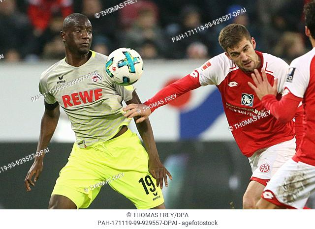 Mainz' Stefan Belland Cologne's Sehrou Guirassy (L) vie for the ball during the Bundesliga soccer match between FSV Mainz 05 and 1