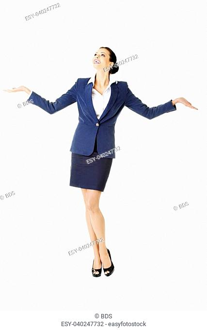 Happy young business woman showing copy space on her palm, isolated on white
