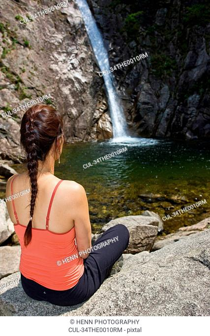 Woman admiring waterfall