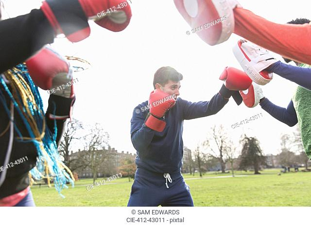 Man boxing in park