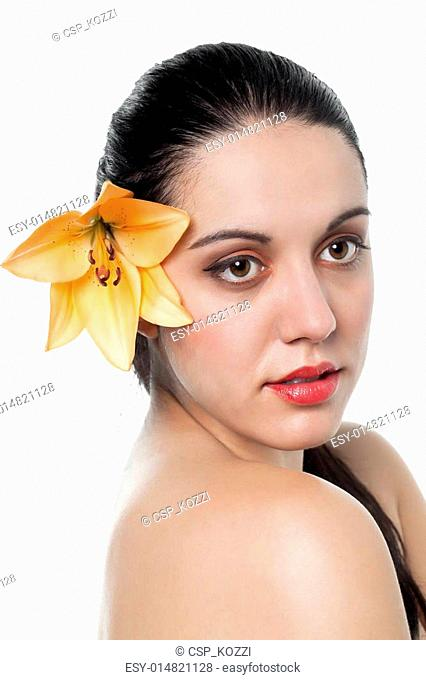 beautiful lady with a flower on ear