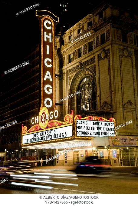 Traffic in front of the main facade of the Chicago Theatre